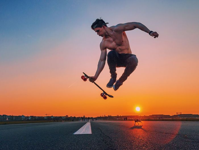 Tempelhof Airport Skateboarding Sunset Sky Real People One Person Nature Lifestyles Full Length Mid-air Sport Motion Clear Sky Outdoors