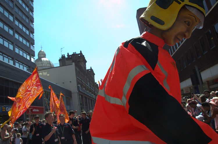 Adult Architecture Building Exterior Built Structure City Crowd Day Flag GreaterManchesterFire&Rescue Large Group Of People Men Orange Color Outdoors People Real People Sky Standing StandingTALL Tall Togetherness Yellowhelmet