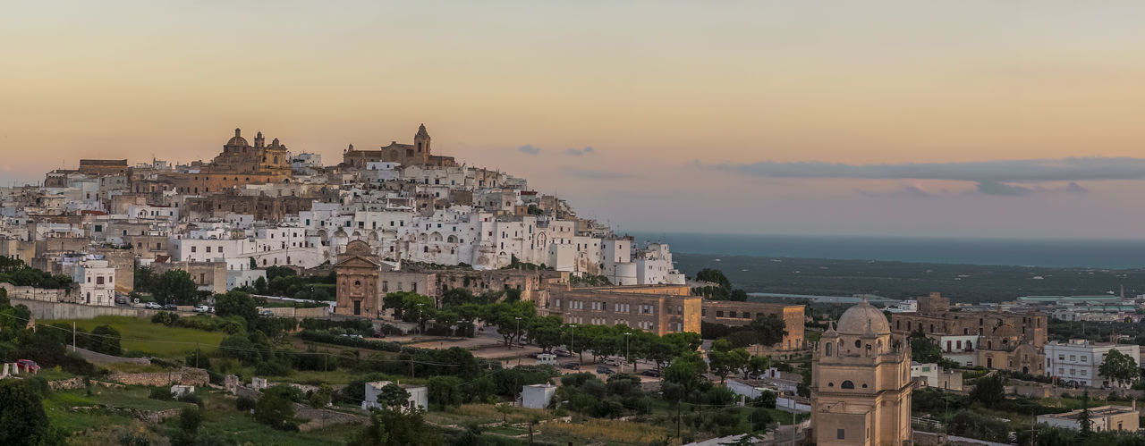 A panoramic view of Ostuni during sunrise Architecture Cathedral Church City Ostuni Panorama View Architecture City Cityscape Hill Italy Nature No People Old Place Of Worship Religion Sea Sky Sunrise Sunset Tourism Travel Destinations Vintage White