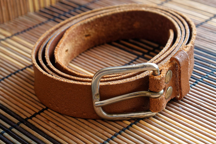 Close-up of belt on place mat