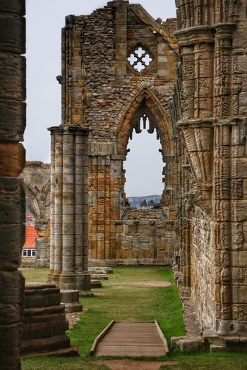 Whitby Whitby Whitby Abbey Architecture History The Past Built Structure Building Exterior Travel Destinations Grass Ancient Day Arch Old Ruin Travel Building Nature Religion Tourism No People Place Of Worship Belief Old Ancient Civilization Outdoors Abbey Archaeology Architectural Column