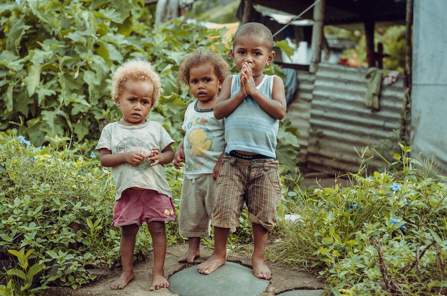 Navala kids Blond Hair Childhood Children Cute Fiji Friendship Full Length Lifestyles Looking At Camera Navala Village Outdoors Portrait Real People Standing Togetherness The Portraitist - 2017 EyeEm Awards