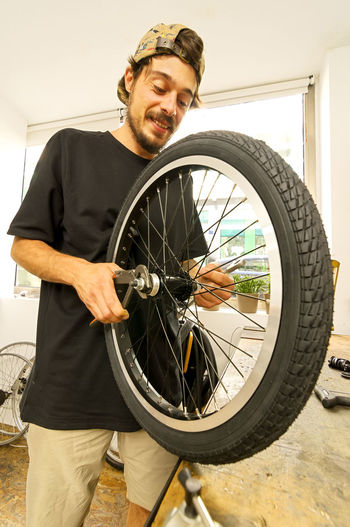 man working in bicycle shop , bike workshop Bikers Worker Workers Workshop Workshop View Bicycle Bicycle Photography Bicycle Shop Bicycles Bike Bike Photography Bike Shop Bikelife Bikes Bycicle Day One Person Real People