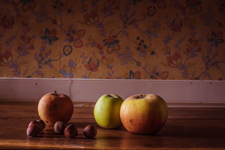 Antique Autumn Nuts StillLife StillLifePhotography Apples Flooring Floral Pattern Food Food And Drink Freshness Fruit Healthy Eating Indoors  Kitchen No People Old Decoration Still Life Table Vintage Wall - Building Feature Wallpaper Wellbeing Wood - Material Wood Table EyeEmNewHere Autumn Mood