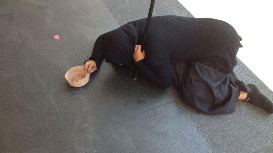 Beggar kneel down on floor