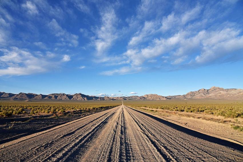 The road to Area 51 near Rachel, Nevada Blue Cloud - Sky Desert Dirt Road Landscape Mountain No People Outdoors Transportation