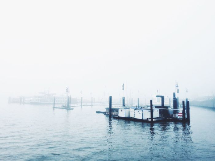 Harbor against sky during foggy weather