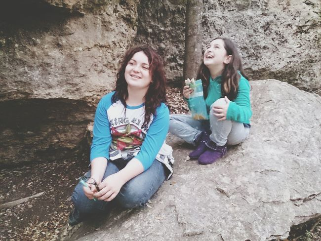 Sisters Enjoying Nature 2 Girls Resting On A Rock Hearty Laughter Austin Texas Mayfield Park And Preserve