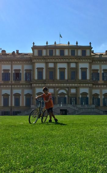 Blue Sky Blue Sky Green Green Color Kid Teenager Teen Young Boy Bike Villa Reale Monza Villa Reale Monza Building Exterior Architecture Bicycle Built Structure Sport Cycling Land Vehicle Grass Real People First Eyeem Photo