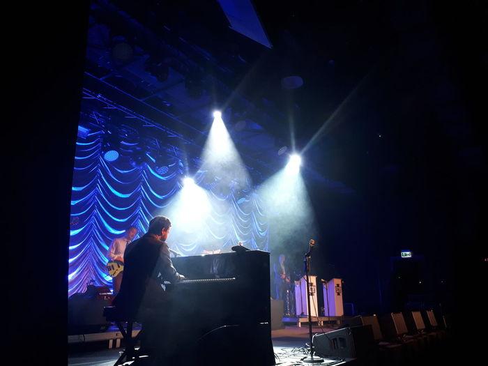 Panoramic shot of illuminated lights at music concert