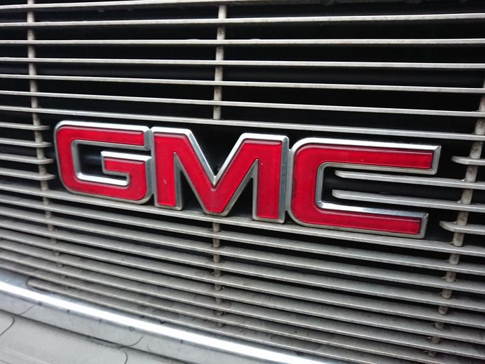 Berlin, Germany - March 28, 2018: GMC logo. The GMC Division of General Motors is a division of the American automobile manufacturer General Motors primarily focusing on trucks and utility vehicles Cars GMC General Motors  Logo Logo Design Car Close-up Editorial  Emblem  Gm  Gmcs No People Red Sign Vehicle Vehicles