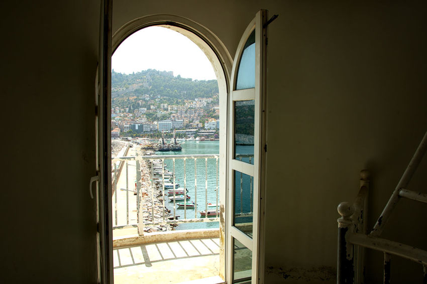 Alanya Coastline Alanya Blue Waters Mediterranean  Mediterranean Sea Turkey Arch Architecture Building Built Structure City Cityscape Glass - Material Indoors  Nature Sea Sky Sunlight Transparent Travel Destinations Vacation Destination Water Window