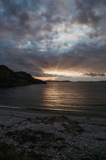 Dramatic Sky Scotland Skye Sunset_collection Travel Travel Photography Beach Beauty In Nature Cloud - Sky Isle Of Skye Landscape Nature No People Outdoors Scenics Scotlandsbeauty Sea Sky Sun Beams Sun Rays Sunset Tranquil Scene Tranquility Travel Destinations Water