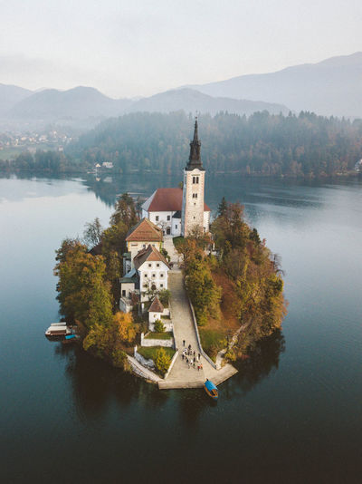 fly so high Architecture Built Structure Water Building Exterior Mountain Religion Nature Spirituality Place Of Worship Travel Destinations Outdoors Sky No People Lake Slovenia Outdoor Photography Nature Nature_collection Drone  Dronephotography Landscape Landscape_Collection Outside Enjoying Life