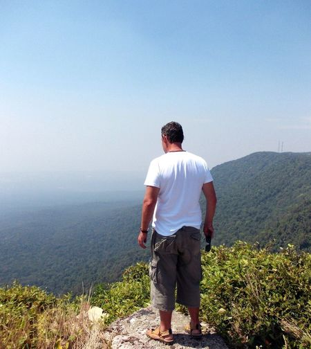 A Bird's Eye View Man Standing Full Length Mountain On The Edge Rear View Casual Clothing Remote Jungle Forest History Khmerrouge Eerie Beautiful Haze Physical Geography Bokor Mountain Kampot Cambodia NeverForget