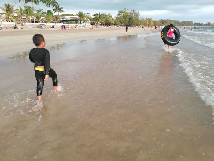 Children enjoy on summer trip 2019,หาดเจ้าหลาว Achi2019 Water Real People Sport Leisure Activity Beach Motion Men Nature Lifestyles Sea Day Childhood Wet Full Length People Incidental People Males  Child Rear View Outdoors