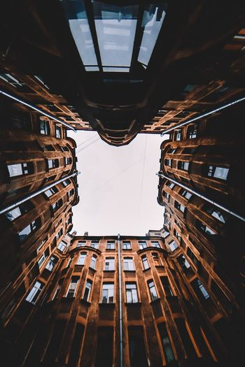 Architecture Built Structure Building Exterior Building No People Low Angle View City Tall - High Outdoors Window Symmetry Reflection Directly Below Day Nature Sky Residential District Pattern Puddle Ceiling