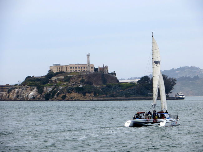 Alcatraz Architecture Building Exterior Built Structure Calm Clear Sky Crimea Day Famous Landmarks Famous Place Gangster Historical Building History Ocean Outdoors Sailing Sailing Boat Sea The Rock Tourism Travel Photography Water