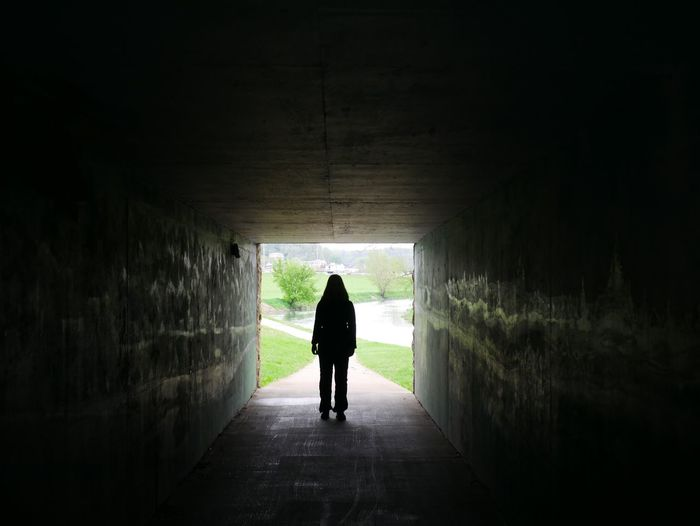 Silhouette Woman Standing In Tunnel