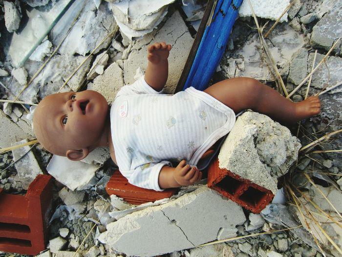 Broken Doll In Demolished Building