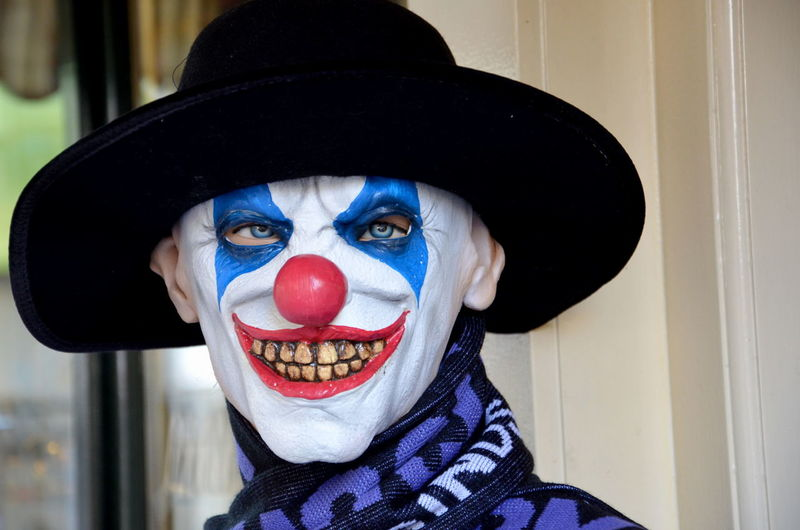 Close-Up Portrait Of Mature Man With Clown Make-Up