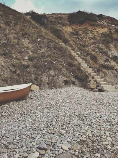 Steep Stairs Boat On Shore Orange Boat Pebbles Seaside Beach Natural Vs Artificial Concrete Steps Retro Storytelling