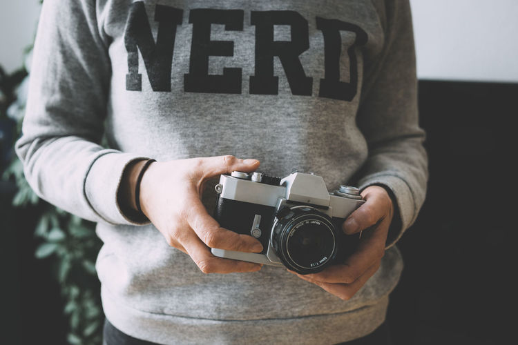 NERD 35mm 35mm Camera Analog Camera Analogue Photography Berlin Camera - Photographic Equipment Holding Lifestyle Nerd One Person One Woman Only Photographer Retro Retro Styled Vintage