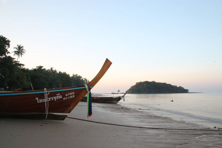 Nature Beach Longtail Boaat Sea Sea And Sky Sky Sunset Water