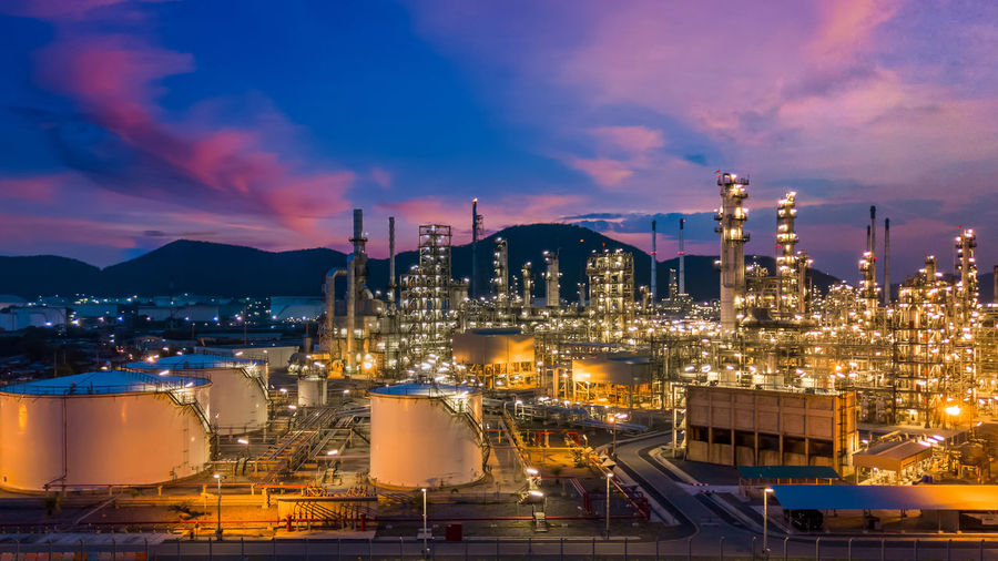 Oil and gas refinery plant and storage tank form industry zone with blu sky background, oil and gas