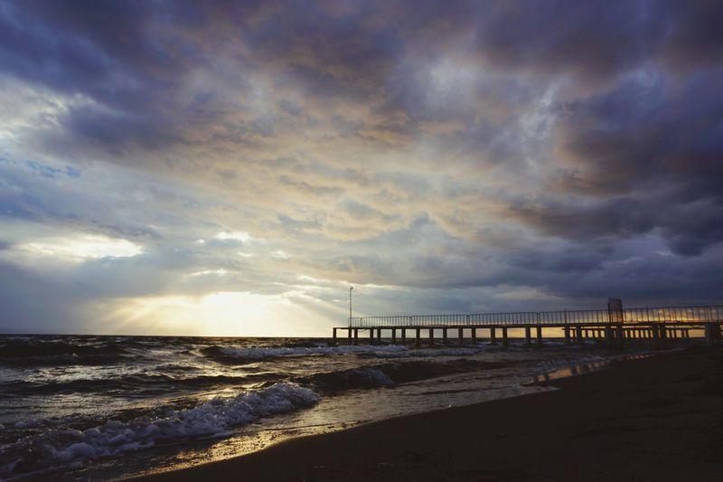 Water Sea Sunset Beach Bridge - Man Made Structure Sand Wave Sunlight Dramatic Sky Sky Storm Cloud Moody Sky Cloudscape Low Tide Sky Only Meteorology Cumulus Cloud Cumulonimbus Atmospheric Mood Coastline