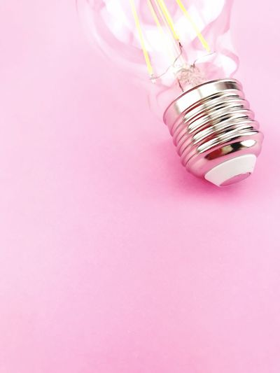 light bulb and pink color Led Bulb Pink Color Copy Space Indoors  No People Studio Shot Pink Background Lighting Equipment Still Life Close-up Colored Background Electricity  High Angle View Shiny Creativity Savings 17.62°