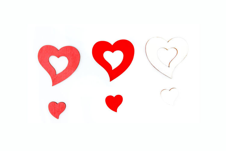 Directly above shot of red heart shape on white background