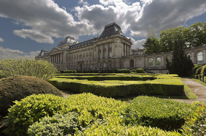Brussels, Belgium. May 3, 2018: Views of the Royal Palace and its gardens in the Belgian capital. Belgium Brussels Place Travel Architecture Building Building Exterior Built Structure Cloud - Sky Day Formal Garden Garden Gardens Grass Green Color Growth History Nature No People Outdoors Plant Royal Palace Sky Sunlight Travel Destinations