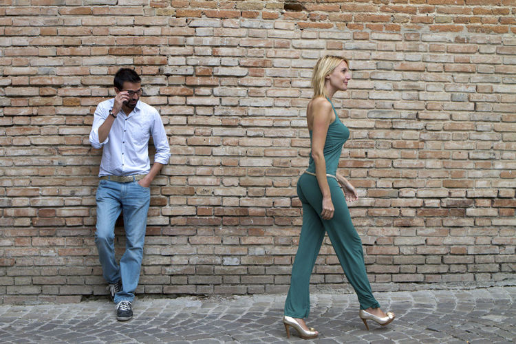Man Standing In A Street And Looking At A Woman