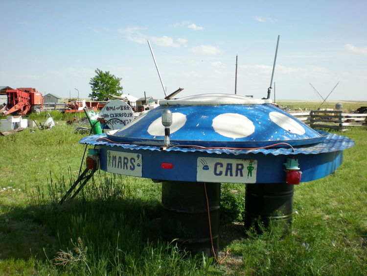 Colorado Junkyard Art Junkyard Scrapmetal UFO UFO Sightings UFO? Ufos Blue Day Field Grass Junkyard Nature No People Outdoors Satire Satirical Sky Tree