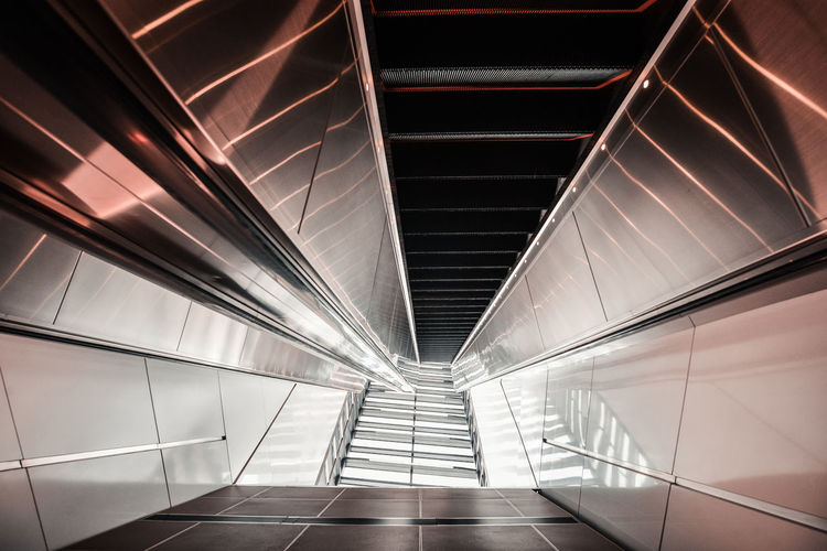 Abstarct Underground Ceiling Direction Escalator Futuristic Illuminated Low Angle View Metallic Modern No People Pattern Steel The Way Forward Urban The Architect - 2018 EyeEm Awards