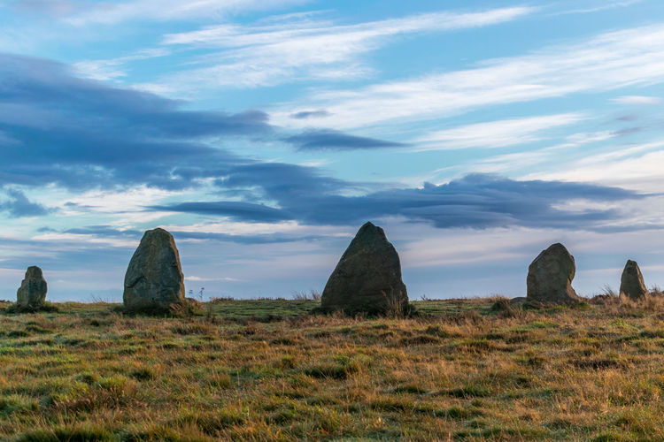 Beauty In Nature Cloud - Sky Day Grass Hill Horizon Over Land Landscape Nature No People Outdoors Scenics Sky Standing Stones Stones