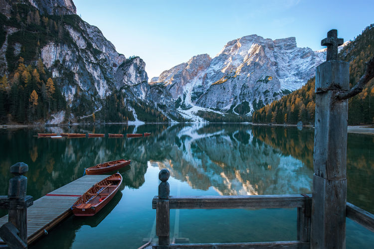 Alpine lake in the alps, Lago di Braies Dolomites, Italy Pier Alps Beauty In Nature Boat Boathouse Cold Temperature Day Idyllic Lago Di Braies Lake Mountain Mountain Range Nature Nautical Vessel No People Outdoors Pragserwildsee Reflection Scenics Snow Tranquil Scene Tranquility Water Winter
