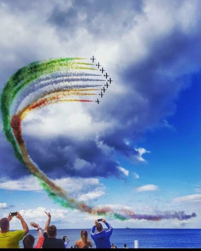 Sky Airshow Cloud - Sky Flying Leisure Activity Mid-air Real People Transportation Vapor Trail Fun Enjoyment Low Angle View Speed Outdoors Motion Men Water Arts Culture And Entertainment Teamwork Mode Of Transport