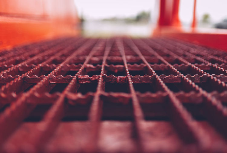 Absence Backgrounds Close-up Day Detail Focus On Foreground Full Frame Grate In A Row Indoors  Metal No People Order Pattern Red Selective Focus String Surface Level Textured  Train