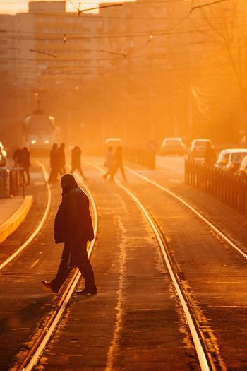 Streetwise Photography Track Architecture Walking Motion Lifestyles Tram Station  Tram Tracks Sillouette Sun Light Sunset Silhouettes Sunset_collection People Walking  City Life Urban Landscape Mist Smog My Best Photo