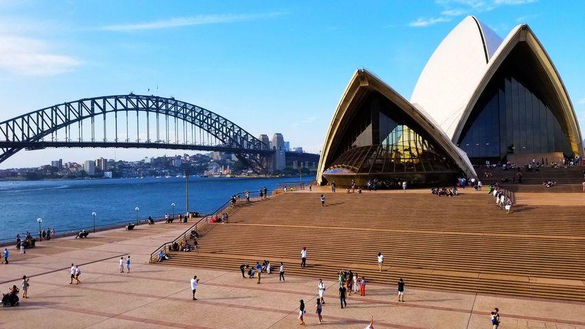 Sydney Opera House & Bridge Landmark Sydney Opera House Sydney, Australia Dronestagram Nature Dronephotography Drone  Traveling Travelblogger Australia Wanderlust Travellife Adventure Dronesdaily Dronelife Droneoftheday Sky Outdoors Day Sea People City