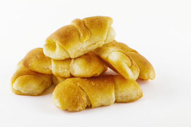 Baked Bread Bun Close-up Crunchy Deep Fried  Fast Food Food Food And Drink Freshness Heap No People Potato Chip Ready-to-eat Salted Stack Unhealthy Eating White Background Yellow