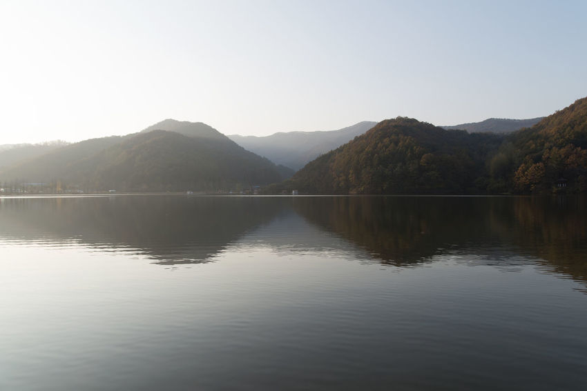 autumn lake of Mungwang Lake in Goesan, Chungbuk, South Korea Fall Beauty Mungwang Lake Autumn Lake Autumn Lakeside Beauty In Nature Clear Sky Day Lake Lake In Autumn Lakeside Mountain Mountain Range Nature No People Outdoors Reflection Scenics Sky Tranquil Scene Tranquility Water Waterfront