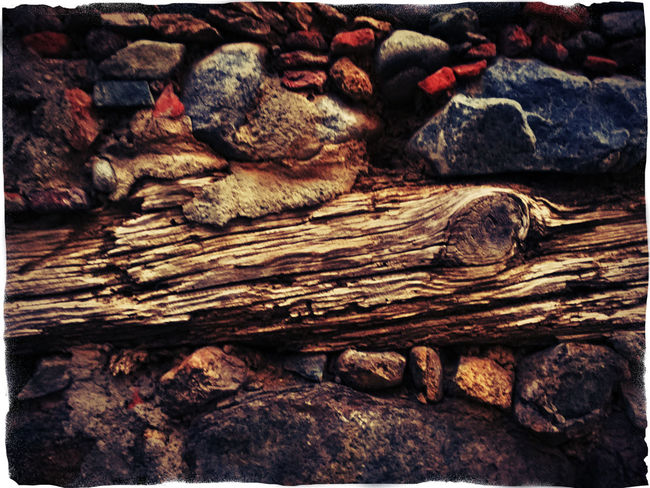 peace of Wood inside a stone wall as door fall Aged Stone Auto Post Production Filter Brown Brown Color Close-up Day Detail Full Frame Outdoors Red Color Rocky Selective Focus Stone Stone Wall Textured  Tranquility Transfer Print Weathered Weathered Wall Wood - Material Wood Inside The Stone Wall