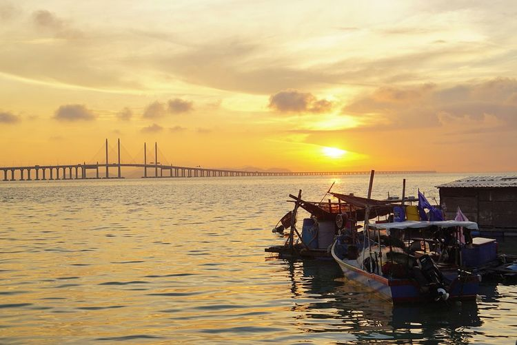 Finding New Frontiers PenangBridge Penang Malaysia Penang Bridge Penang Island Penang Photography Penang View Penangbeach Sunrise Sunset Water Transportation Sea Sky Travel Destinations Travel Reflection Business Finance And Industry Outdoors Nautical Vessel No People Beauty In Nature Landscape Tranquil Scene Horizon