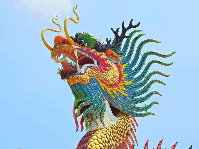 Low Angle View Of Statue Of Dragon Against Clear Sky