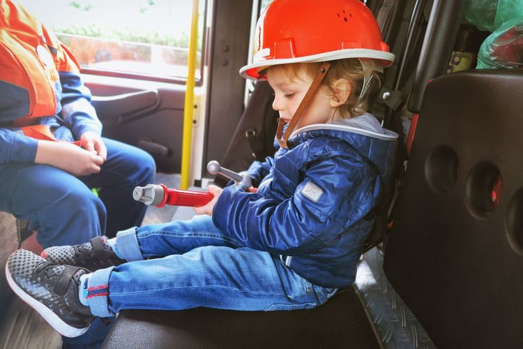 Close-up of boy sitting in fire truck