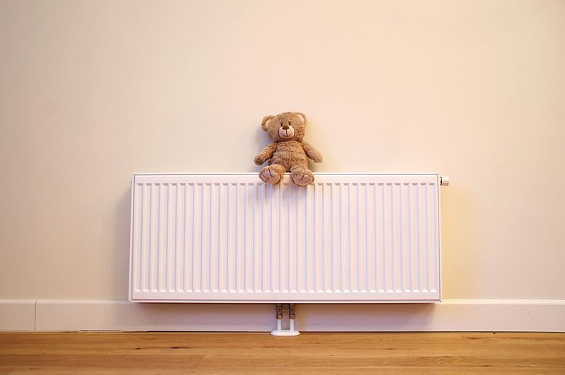 Teddy bear sitting on a radiator Warmth Copy Space Warm Energy Comfortable Heating Home EyeEm Selects Toy Indoors  Stuffed Toy Teddy Bear No People Sitting