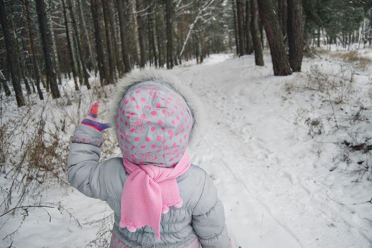 Child In Snow Covered Forest